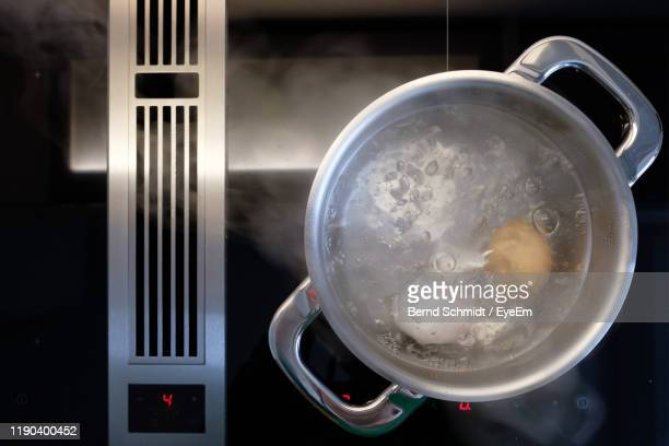 high angle view of water in container - boiling stock pictures, royalty-free photos & images