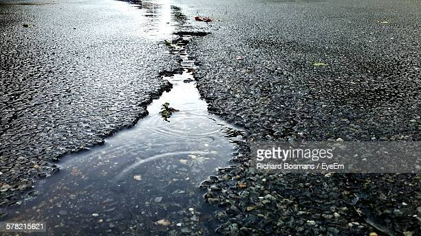 High Angle View Of Water Puddle In Street Crack