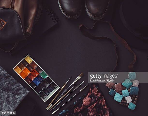 high angle view of watercolor paints and paintbrush by necklace - lutai razvan stock pictures, royalty-free photos & images