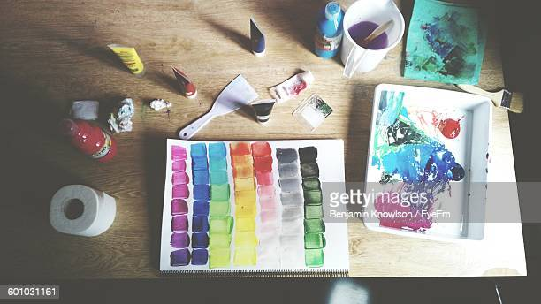 High Angle View Of Watercolor Palette On Wooden Table