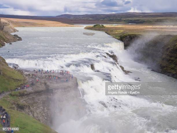 high angle view of waterfall against sky - angela rohde stock-fotos und bilder