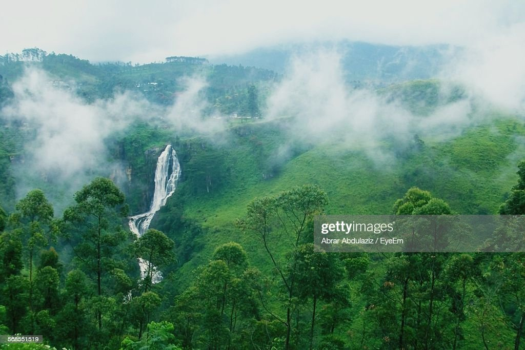High Angle View Of Waterfall And Mountains On Foggy Day : Stock Photo