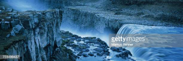 high angle view of waterfall from rocky cliff, dettifoss, iceland - dettifoss waterfall stock photos and pictures
