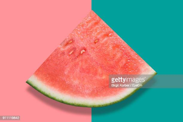High Angle View Of Watermelon Over Colored Background