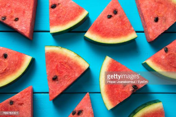high angle view of watermelon slices on table - watermelon stock pictures, royalty-free photos & images