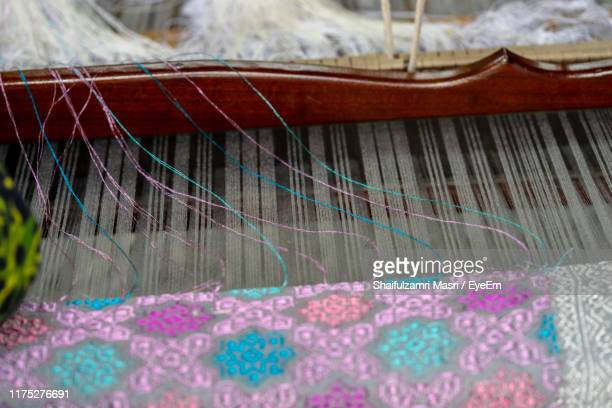 high angle view of weaving machinery - shaifulzamri eyeem stock pictures, royalty-free photos & images