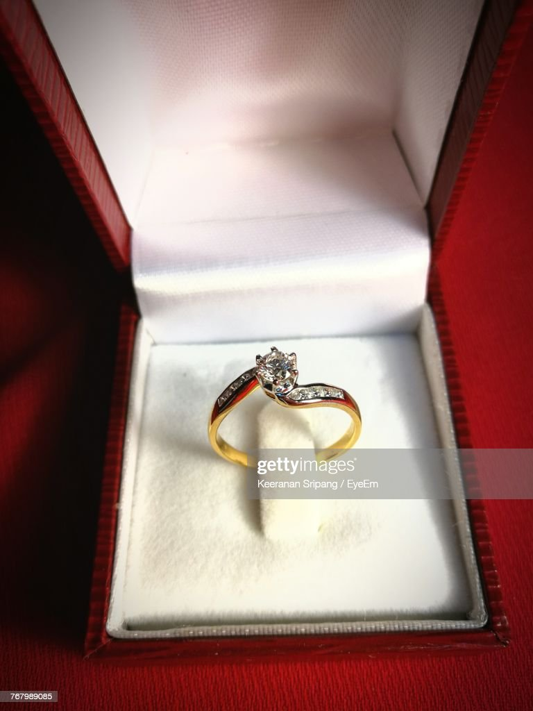High Angle View Of Wedding Rings In Box : Stock Photo