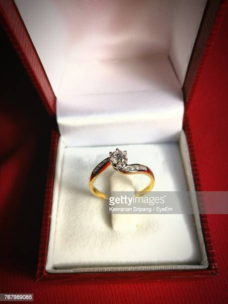 high angle view of wedding rings in box - engagement ring box stock photos and pictures