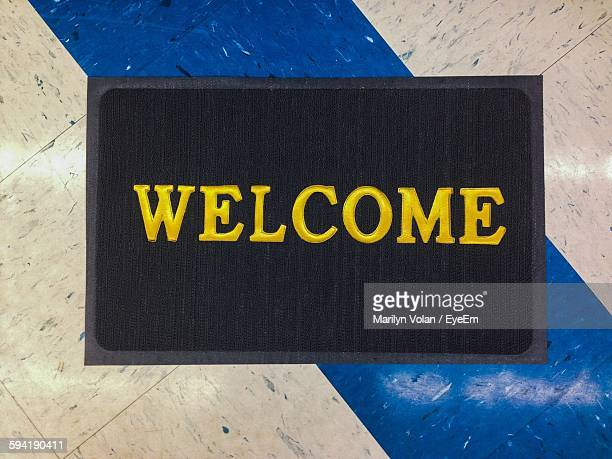 High Angle View Of Welcome Doormat On Floor