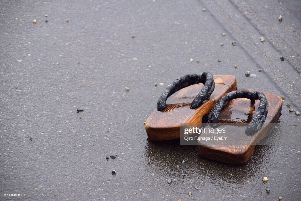 636e52326a85c4 High Angle View Of Wet Geta Sandal On Street In Rain Stock Photo ...