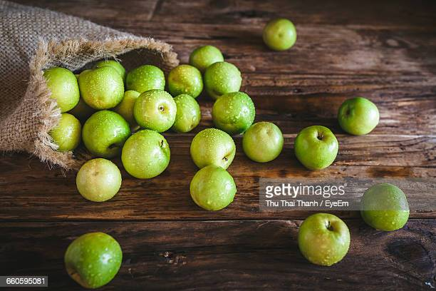 High Angle View Of Wet Granny Smith Apples On Table