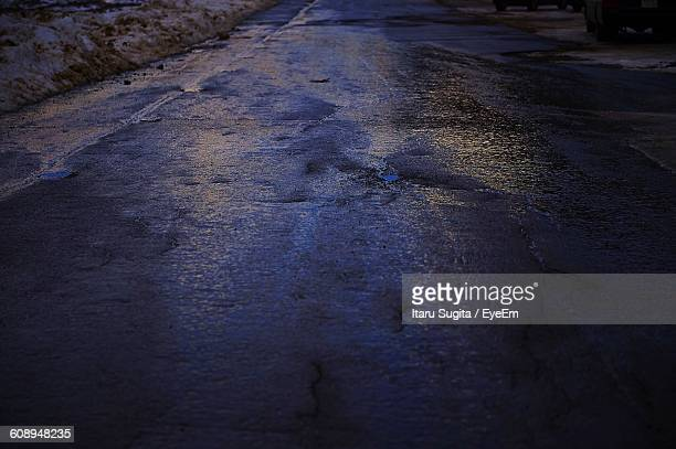 High Angle View Of Wet Road At Dusk During Winter