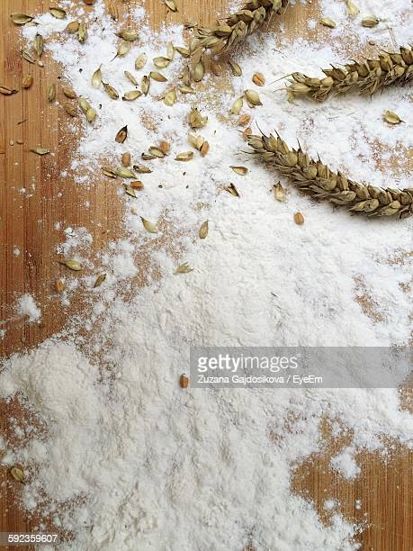 High Angle View Of Wheat And Flour On Table