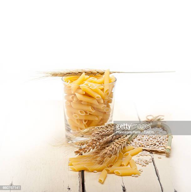 High Angle View Of Wheat And Pasta On Table