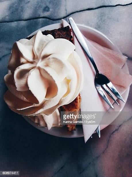 High Angle View Of Whipped Cream On Apple Pie Served In Plate On Table