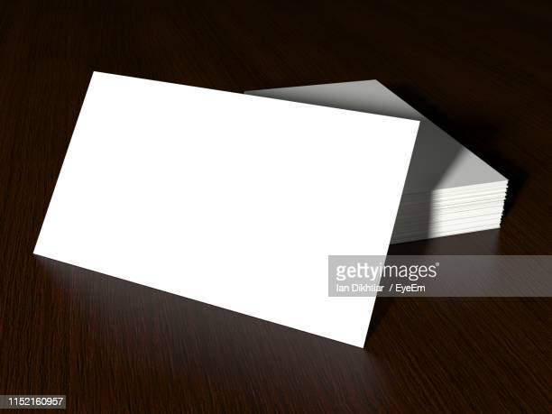 high angle view of white blank signs on wooden table - 名刺 ストックフォトと画像