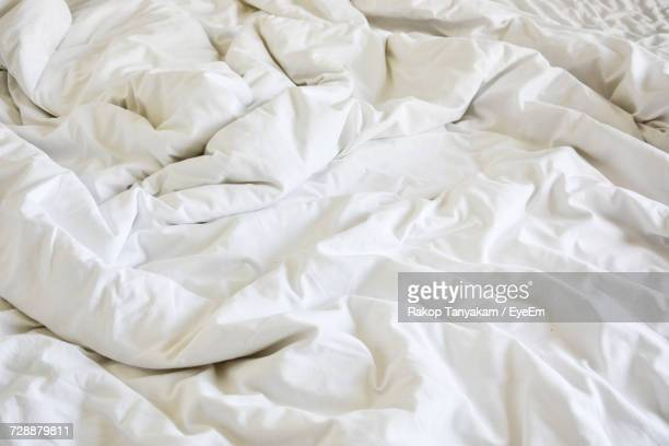 High Angle View Of White Blanket On Bed At Home