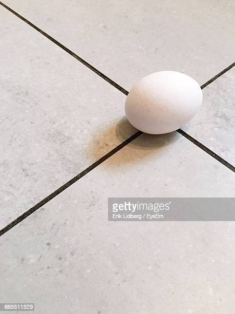 High Angle View Of White Egg On Table