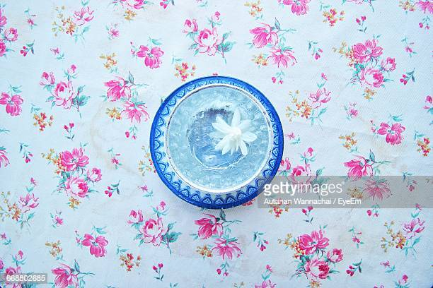 High Angle View Of White Flower In Water On Table
