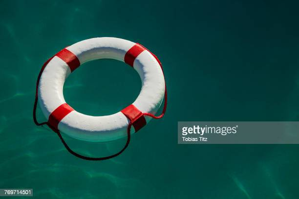 High angle view of white life ring floating on sea