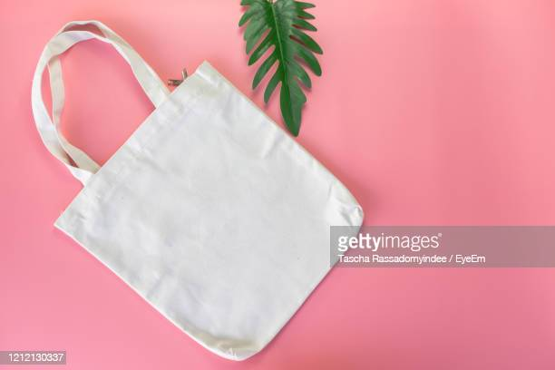 high angle view of white paper on table - tote bag stock pictures, royalty-free photos & images