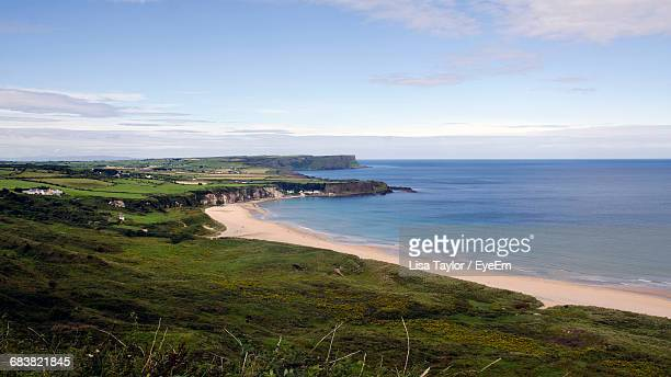 high angle view of white park bay, county antrim, north ireland  - county antrim stock pictures, royalty-free photos & images