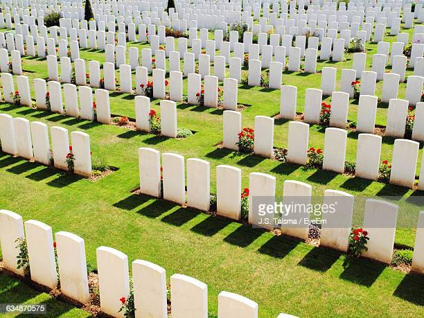high angle view of white tombstones in military graveyard - place of burial stock pictures, royalty-free photos & images