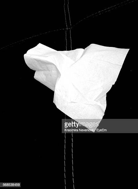High Angle View Of White Towel On Black Textile