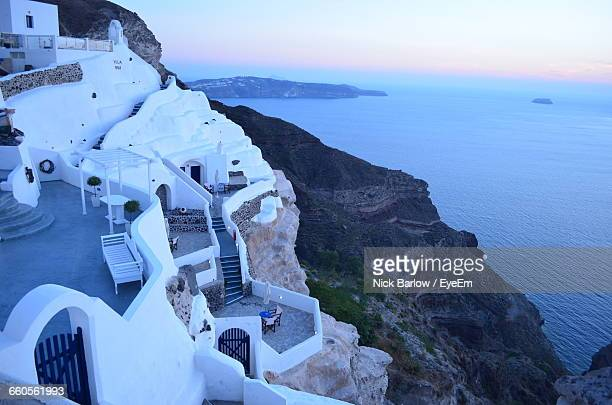 High Angle View Of Whitewashed Houses At Santorini Against Aegean Sea