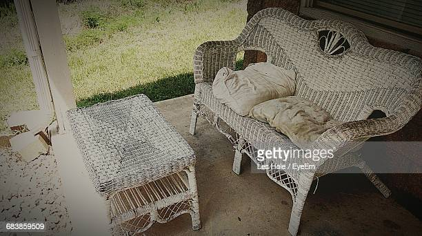 High Angle View Of Wicker Coffee Table And Sofa At Porch