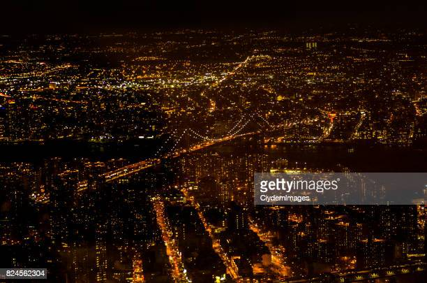 high angle view of williamsburg bridge through one world trade center's observation point at night - williamsburg new york city stock pictures, royalty-free photos & images