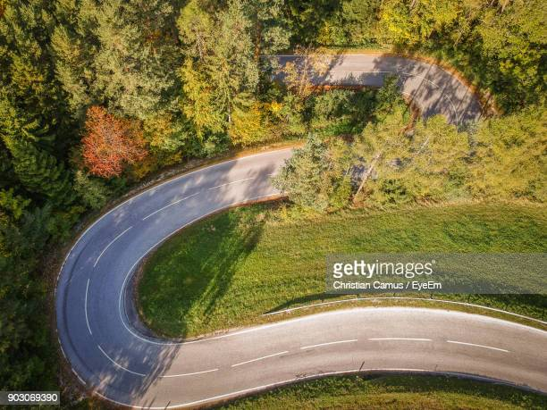 High Angle View Of Winding Road On Field