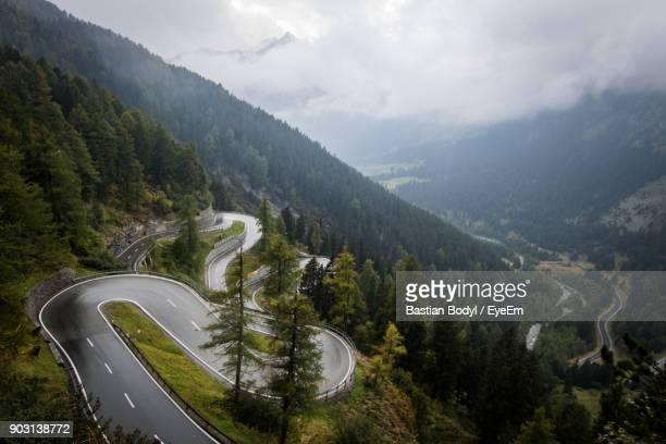 High Angle View Of Winding Road On Mountains