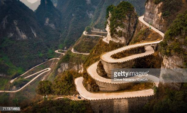 high angle view of winding road - tianmen stock pictures, royalty-free photos & images