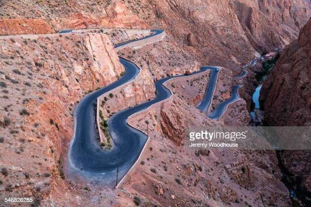 high angle view of winding switchback road on mountain slope - danger stock pictures, royalty-free photos & images