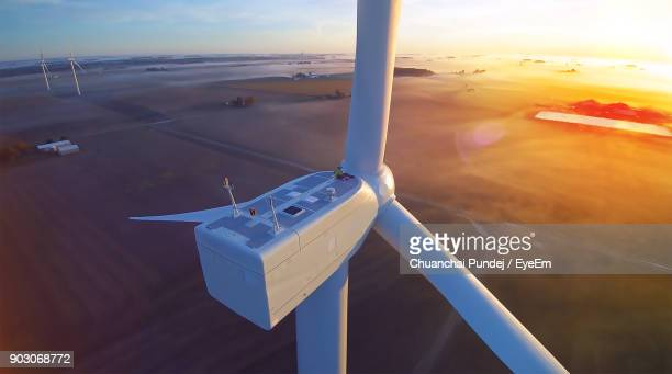 high angle view of windmill during sunset - windmills stock photos and pictures