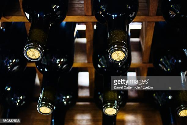 High Angle View Of Wine Bottles On Rack At Store