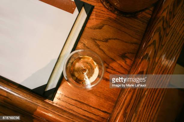 high angle view of wine glass at bar - wood table top stock photos and pictures