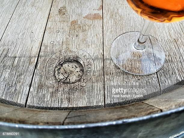 High Angle View Of Wineglass On Cask