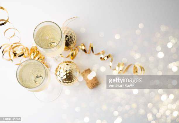 high angle view of wineglasses with christmas decorations on table - christmas still life stock pictures, royalty-free photos & images