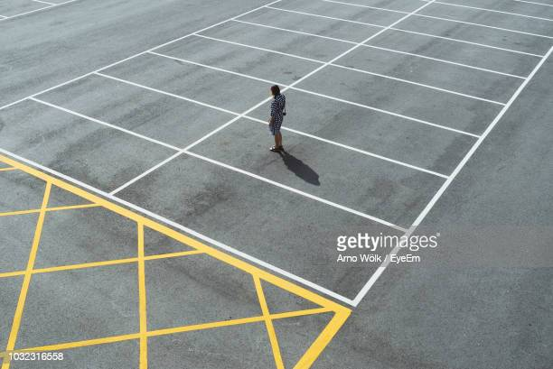 high angle view of woman at parking lot - car park stock pictures, royalty-free photos & images