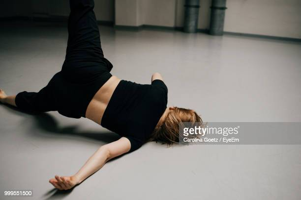 High Angle View Of Woman Dancing On Floor