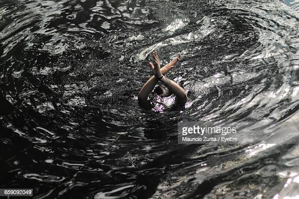 High Angle View Of Woman Drowning In Water