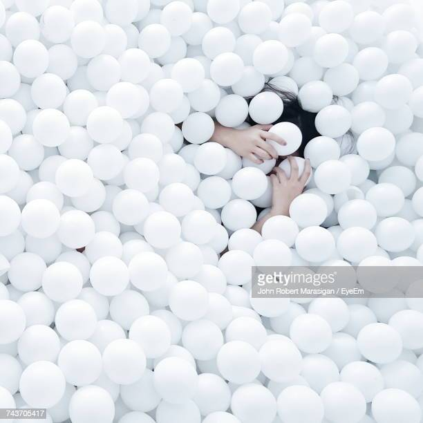 high angle view of woman enjoying in white ball pool - 物の集まり ストックフォトと画像