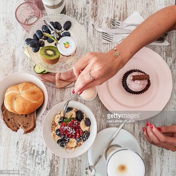High Angle View Of Woman Having Breakfast