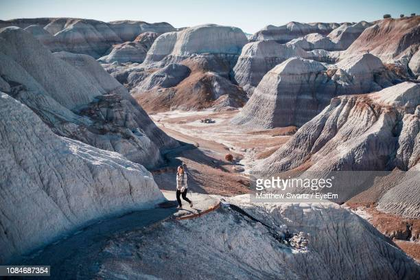 high angle view of woman hiking on mountain - nevada stock-fotos und bilder