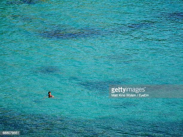 High Angle View Of Woman In Sea