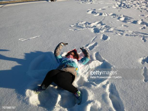 High Angle View Of Woman In Snow