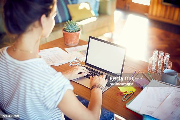 High angle view of woman is working at desk
