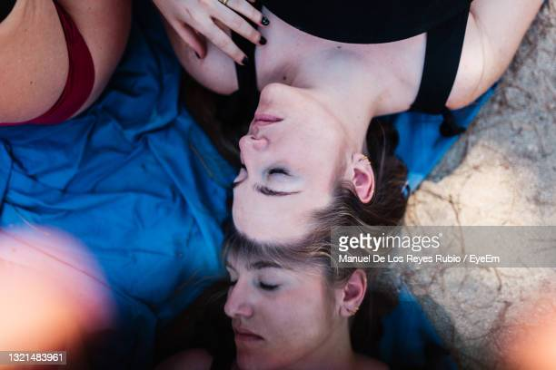 high angle view of woman lying on floor - after party stock pictures, royalty-free photos & images